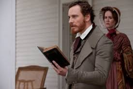 Edwin Epps (Michael Fassbender) reads from the Bible