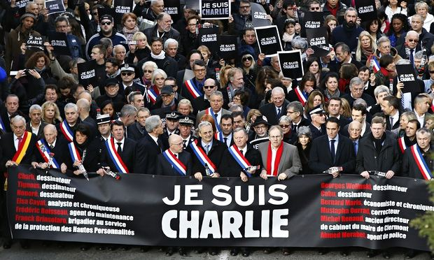 Officials join hundreds of thousands of people on a Je Suis Charlie march in Nice, France